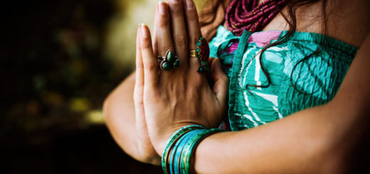 63850290 - woman practice yoga outdoor close up of hands in namaste gesture